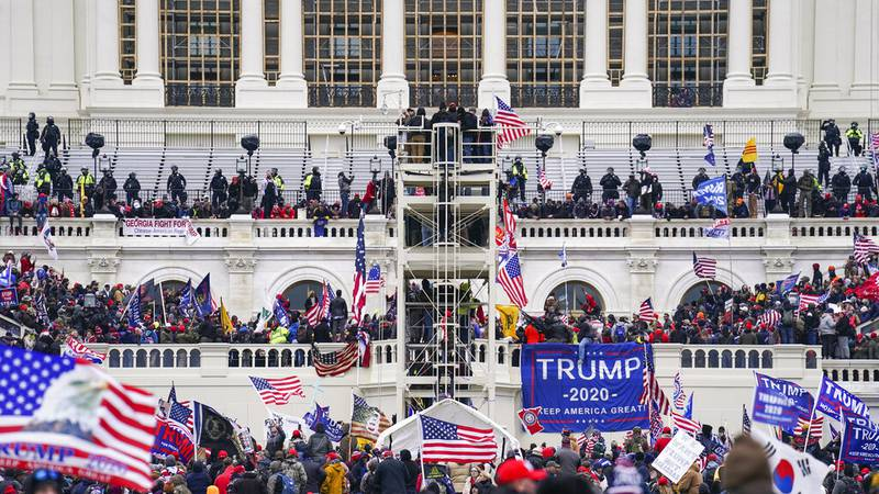 FILE - In this Jan. 6, 2021, file photo insurrectionists loyal to President Donald Trump breach...