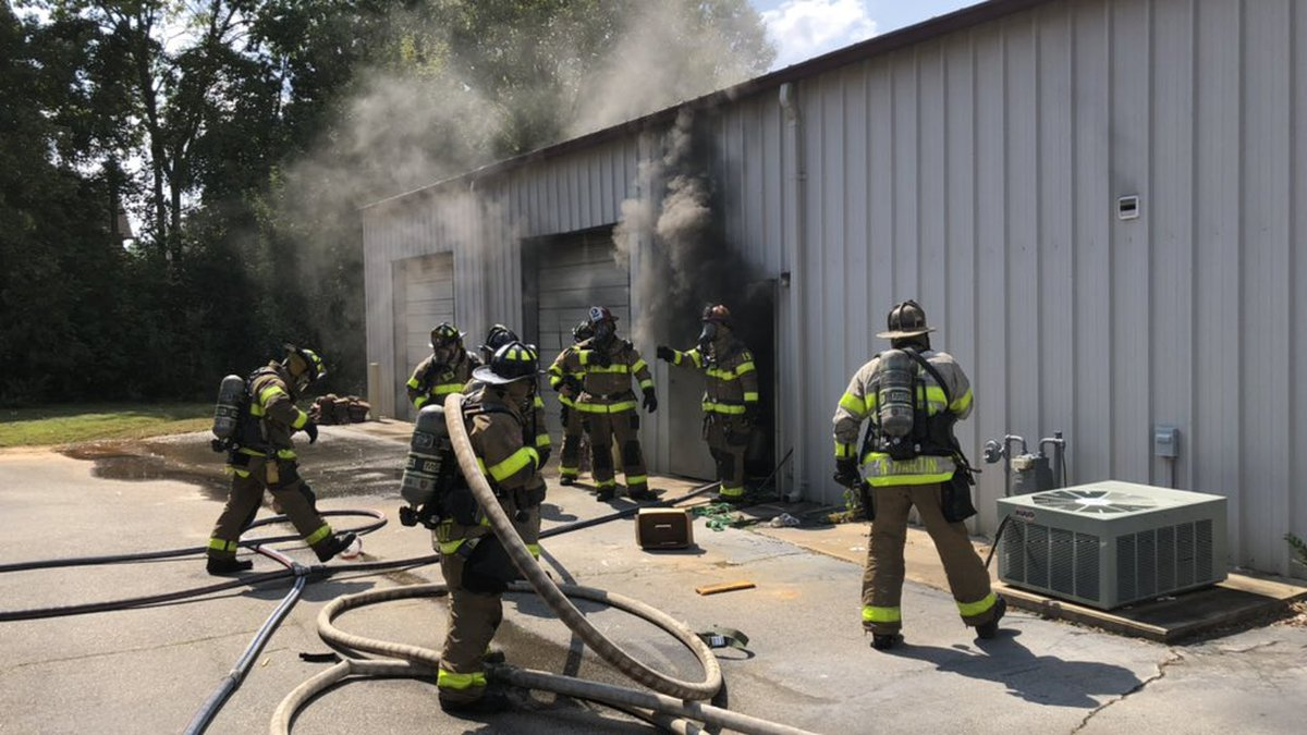 The fire was in a vehicle in an attached garage on the property.