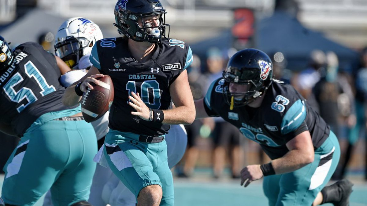 Coastal Carolina quarterback Grayson McCall (10) looks for a receiver during the first half of...