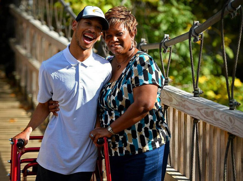 Chancellor Lee Adams (left) has been raised by his grandmother, Saundra Adams (right), and is...