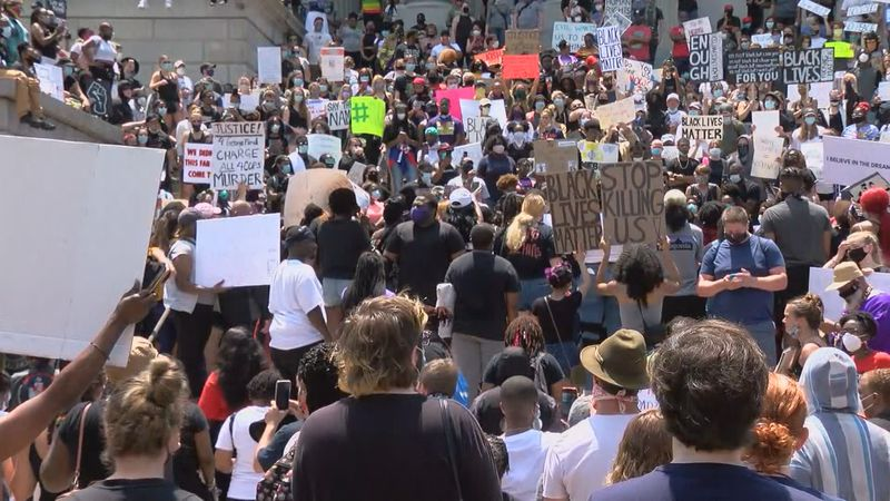 Hundreds, if not more than a thousand, people gathered to hear speakers address police...