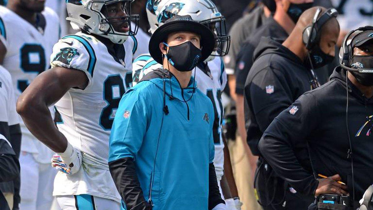 Injured Carolina Panthers running back Christian McCaffrey watches a replay on the Jumbotron...