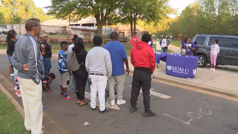 A vigil for a homicide victim in west Charlotte came to an abrupt end after nearby gunfire.