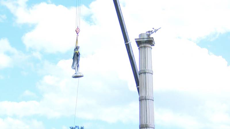 After more than 17 hours, workers have brought down the statue of former United States Vice...