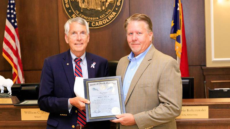 """Concord City Council and Mayor William C. """"Bill"""" Dusch presented retired Electric Systems..."""