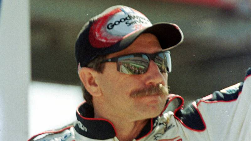 FILE - In this file photo taken Feb. 18, 2001, Dale Earnhardt waves to fans during race...