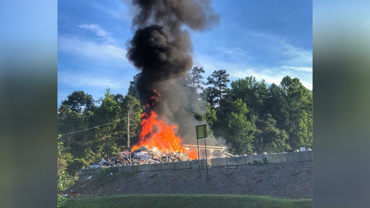 Recycling center fire closes road in Huntersville