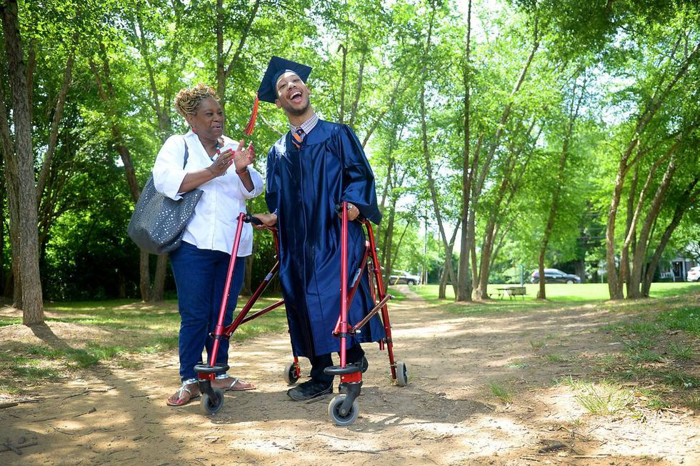 Saundra Adams, left, claps for her grandson Chancellor Lee Adams, right, as a small group of...