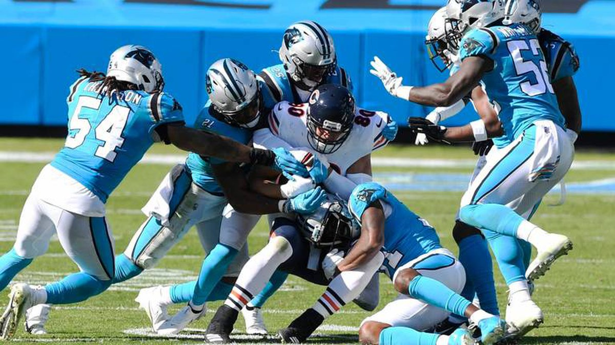 Chicago Bears tight end Jimmy Graham (80) is gang tackled by the Carolina Panthers defense in...