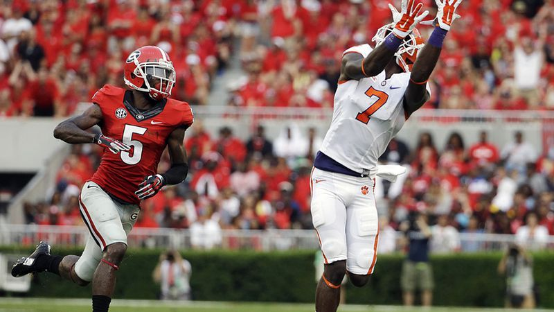 Clemson wide receiver Mike Williams, right, catches a pass in front of Georgia cornerback...