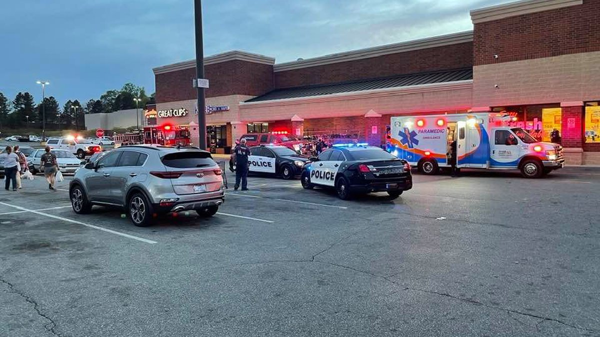 A witness said shoppers hurried out of the store after hearing the gun shot.