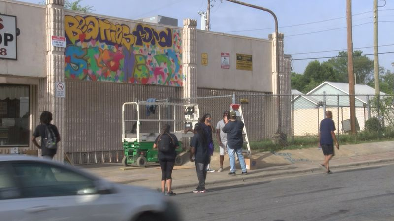 After a deadly shooting on Beatties Ford Road, artists look to bring the community together...