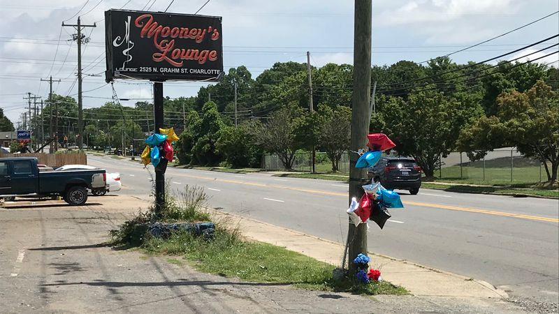 Balloons mark the site of a shooting early Saturday morning.