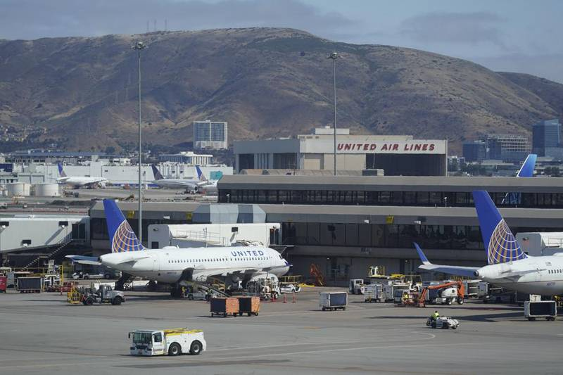 FILE - United Airlines planes are seen parked at San Francisco International Airport with a...