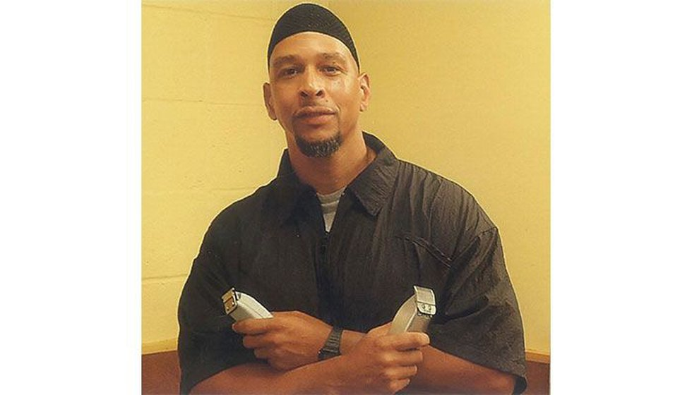 Photo of Rae Carruth, working as a barber inside prison, provided to WBTV.