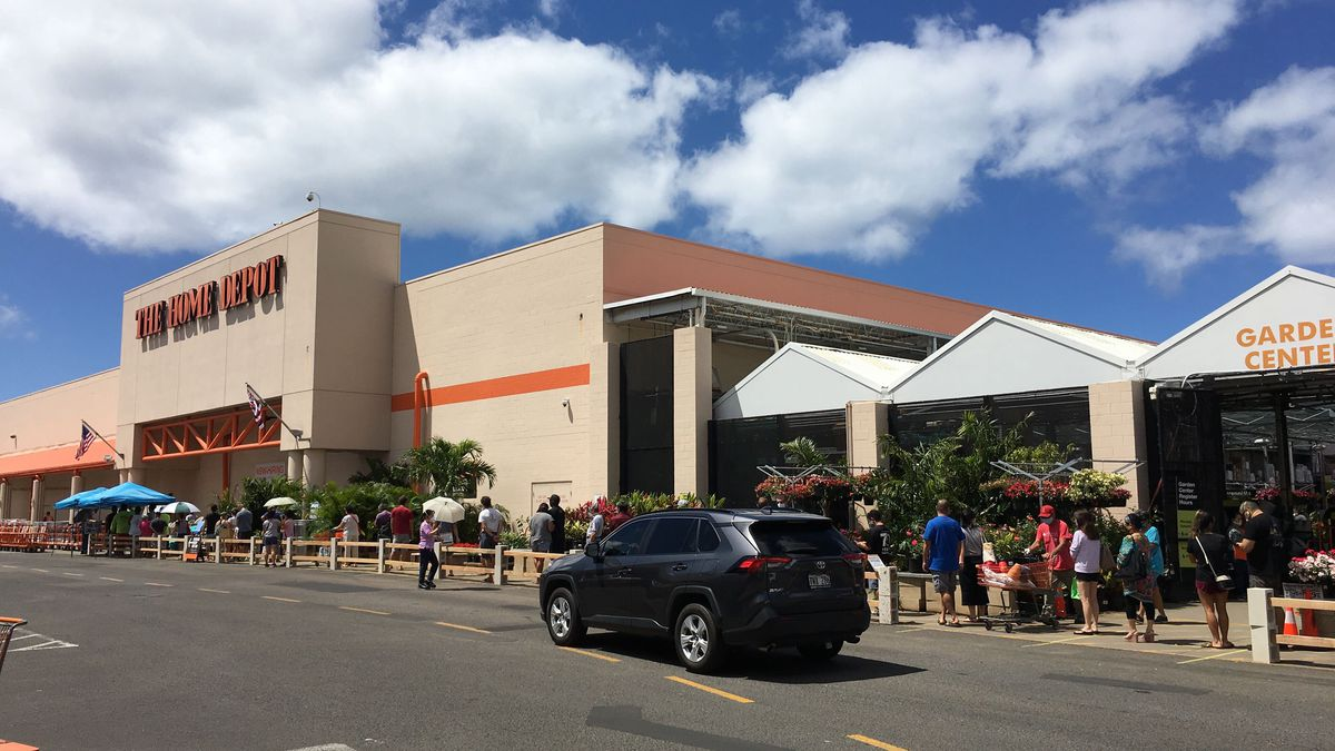 The line outside of the Home Depot stretched out the door with patrons standing closer than six...